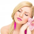 Romantic blonde woman with pink orchid — Stock Photo #30352795