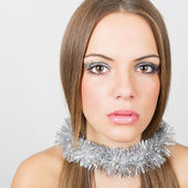 Gorgeous young woman with silver decoration and makeup — Stock Photo