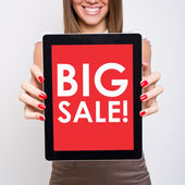 Big sale text on red tablet pc screen — Stock Photo