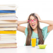 Surprised student girl with books — Stock Photo