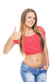 Pretty teenage girl showing thumb up smiling — Stock Photo