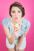Cute young retro woman eating ice-cream in cornet — Stock Photo