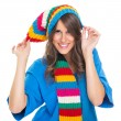 cute young woman wearing colorful winter hat and scarf — Stock Photo
