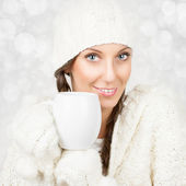 Christmas girl in white drinking tea — Stock Photo
