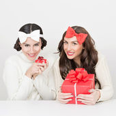 Cute teenage girls with Christmas presents — Stok fotoğraf