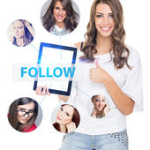 Cute young woman following friends online — Stock Photo