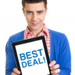 Young man holding a tablet that states best deal — Stock Photo