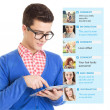 Young guy using social network on tablet computer — Stock Photo