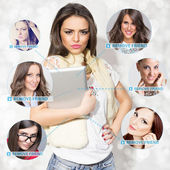 Young woman with tablet removing friends from social network — Stock Photo