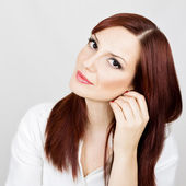 Redhead woman face lifting concept — Stock Photo