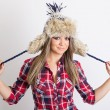 Cute fashionable young woman wearing fluffy winter hat — Stock Photo #34088935