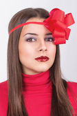Gorgeous young woman dressed for Christmas eve — Stock Photo