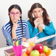 Two cute teenage schoolgirls studying together — Foto Stock