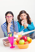Two cute teenage schoolgirls studying together — Stock Photo