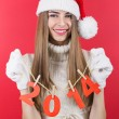 Cute happy teenage Santa girl holding new year numbers decoration — Stock Photo