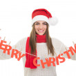Happy woman with Merry Christmas text decoration — Stock Photo