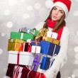 Happy young woman holding many gift boxes — Stok fotoğraf