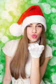 Excited Santa girl blowing kisses — Stock Photo