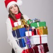 Cute young woman with a lot of presents — Stock fotografie