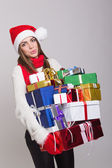 Cute young woman with a lot of presents — Stockfoto