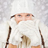 Cute young woman wearing white hat and gloves — Stock Photo