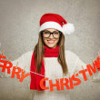 Beautiful young Santa girl with Merry Christmas text decoration — Stok fotoğraf
