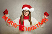 Beautiful young Santa girl with Merry Christmas text decoration — Stockfoto