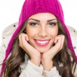 Stock Photo: Beautiful teenage girl wearing pink winter knit beanie
