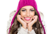 Beautiful teenage girl wearing pink winter knit beanie — Stock Photo