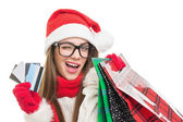 Cute young woman Christmas shopping — Stock Photo