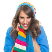 Beautiful young woman wearing colorful beanie and scarf smiling — Stock Photo