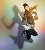 Happy urban teenage girl jumping — Stock Photo