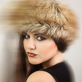 Gorgeous brunette wearing brown fur hat — Stock Photo