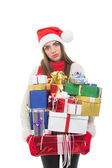Tired young woman carrying many gifts — Stock Photo