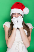 Cute bashful teenage girl with Santa hat — Stock Photo