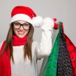 Excited young woman shopping for Christmas — Stock Photo