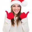 Excited young woman showing thumbs up — Stock Photo #36457741