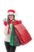 Xcited young woman Christmas shopping — Stock Photo