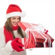 Happy young woman opening a gift — Stock Photo