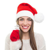 Cute Santa girl showing silver star Christmas decoration — Stock Photo
