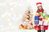 Young tired woman in Christmas euphoria with many presents — Stock Photo