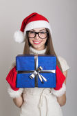 Happy teenage girl holding a blue gift box — Stock Photo