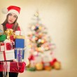 Young tired woman holding heavy Christmas presents — ストック写真