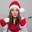 Cute young Santa girl with coffee cup — Stock Photo #37340309