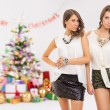 Stock Photo: Two fashionable young women celebrating Christmas