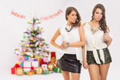 Two fashionable young women celebrating Christmas — Stock Photo