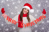 Happy Santa girl showing Merry Christmas sign — Foto Stock