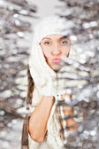 Cute young woman in white among sparkling Christmas decoration — Stock Photo