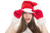Surprised girl wearing Santa hat — Stock Photo