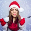 Santa girl enjoying coffee in winter — Stock Photo